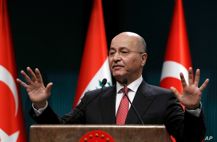 Iraq's President Barham Salih speaks to the media during a joint news conference with Turkey's President Recep Tayyip Erdogan, in Ankara, Turkey, Jan. 3, 2019.