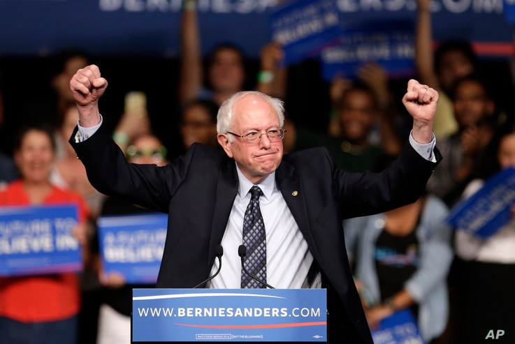 Democratic presidential candidate Sen. Bernie Sanders of Vermont acknowledges his supporters upon his arrival at a campaign rally in Miami, March 8, 2016.