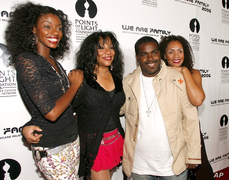 "FILE - Joni Sledge (second from left) with Rodney Jerkins, her niece Camille Sledge (left) and her cousin Amber Sledge. Sledge, who with her sisters formed Sister Sledge and recorded the defining dance anthem ""We Are Family,"" has died, the band's rep..."