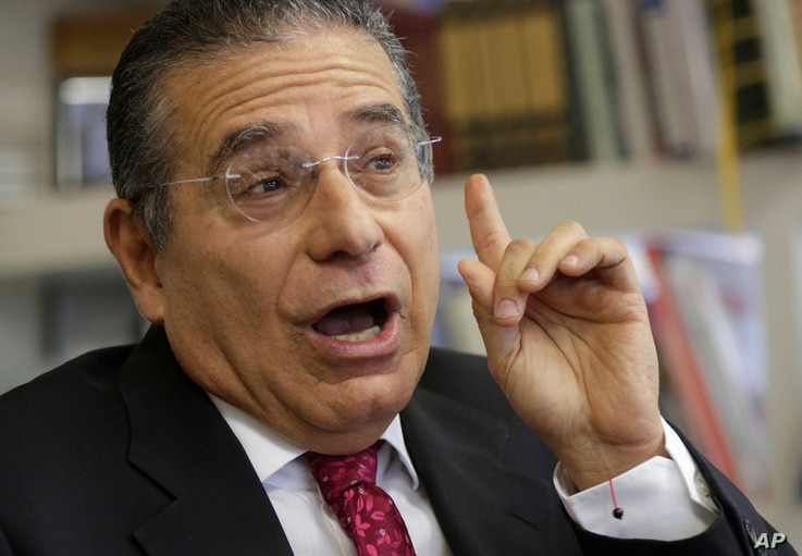 FILE - Partner of the Panama-based law firm Mossack Fonseca, Ramon Fonseca speaks during an interview at his office in Panama City,, April 7, 2016.