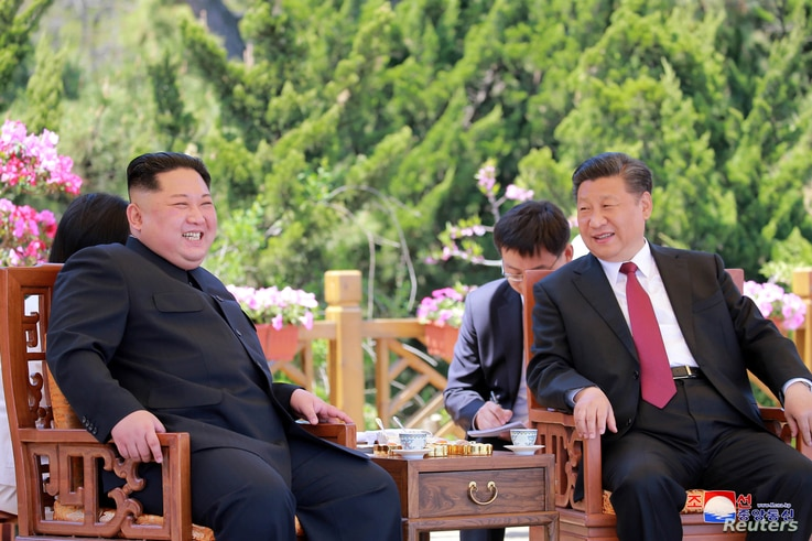 North Korean leader Kim Jong Un meets with China's President Xi Jinping, in Dalian, China in this undated photo released on May 9, 2018 by North Korea's Korean Central News Agency (KCNA).