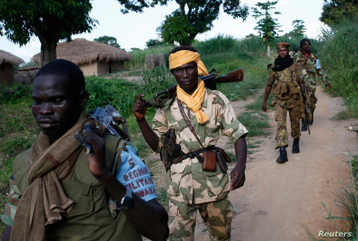 Seleka fighters patrol as they search for Anti-Balaka Christian militia members in the town of Lioto June 6, 2014.