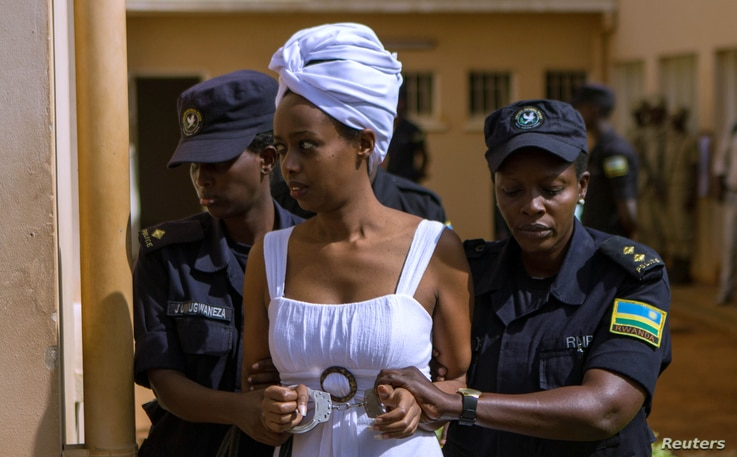 Diane Shima Rwigara, a prominent critic of Rwanda's president Paul Kagame, is escorted by police officers into a courtroom in Kigali, Rwanda, Oct. 11, 2017.