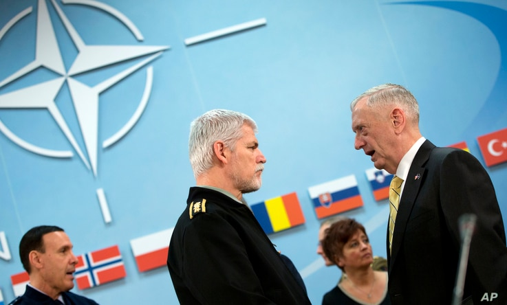 Chairman of the Military Committee, General Petr Pavel speaks with U.S. Secretary of Defense Jim Mattis, right, during a meeting of the North Atlantic Council at NATO headquarters in Brussels, Feb. 16, 2017.