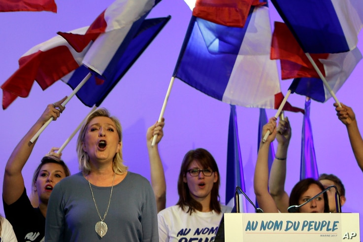 "FILE - France's far-right National Front president Marine Le Pen sings the French National anthem ""La Marseillaise"" after her speech in Frejus, southern France, Sept. 18, 2016."