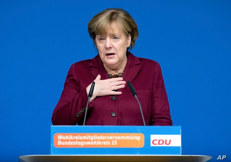 German Chancellor Angela Merkel delivers a speech at a local meeting of her Christian Democrats, CDU, in Grimmen, northern Germany, Jan. 28, 2017.