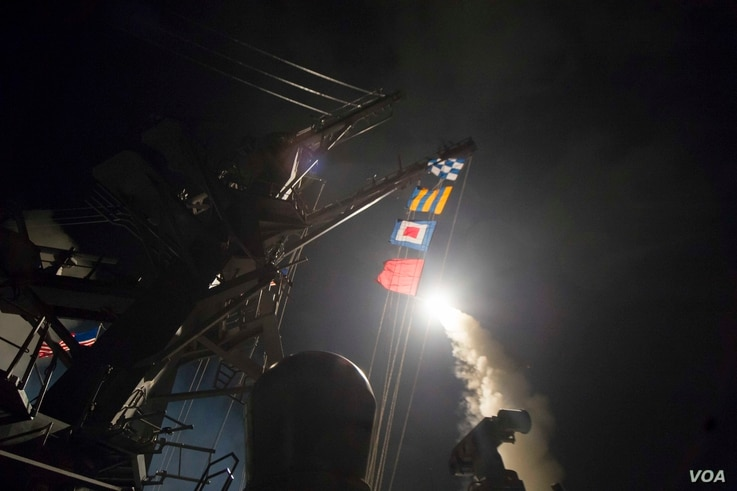 USS Ross fires a tomahawk land attack missile, April 7, 2017. USS Ross, an Arleigh Burke-class guided-missile destroyer, is conducting naval operations in the U.S. 6th Fleet area of operations in support of U.S. national security interests in Europe ...