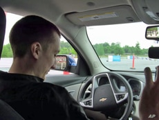 Kevin Schumann, 19, tests his driving skills - with and without distractions - on an obstacle course in Washington, DC.