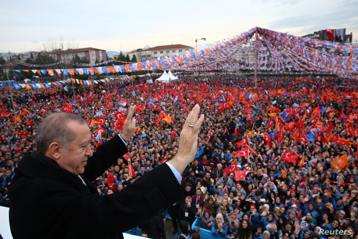 FILE - Turkish President Tayyip Erdogan greets his supporters during a rally in Bursa, Turkey, Jan. 21, 2018.