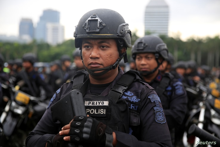 Mobile brigade policemen stand during a ceremony ahead of the Christmas and New Year's celebrations in Jakarta, Indonesia, Dec. 21, 2017.