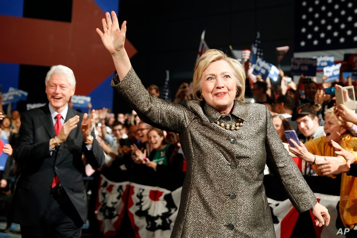 Democratic presidential candidate Hillary Clinton and Former President Bill Clinton move to the stage at her presidential primary election night rally, April 26, 2016, in Philadelphia.