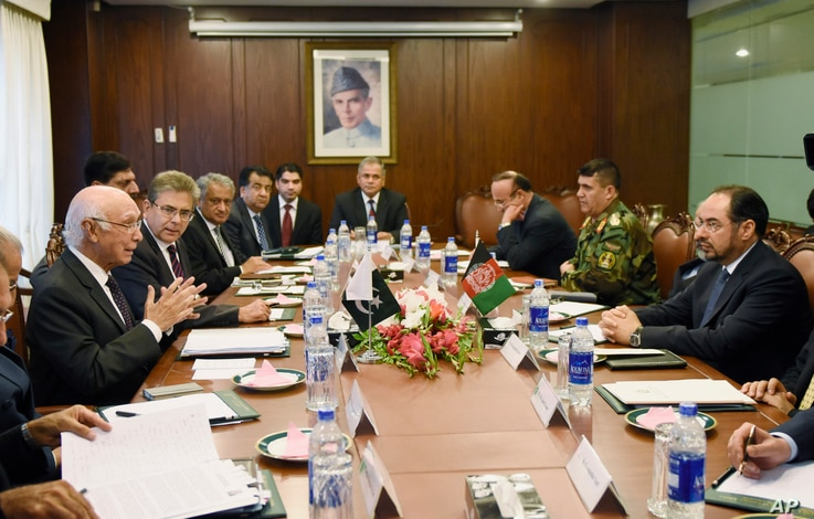 Pakistan's National Security Advisor Sartaj Aziz, far left, holds talks with Afghan Foreign Minister Salahuddin Rabbani, far right, at the Foreign Ministry in Islamabad, Pakistan, Aug. 13, 2015.