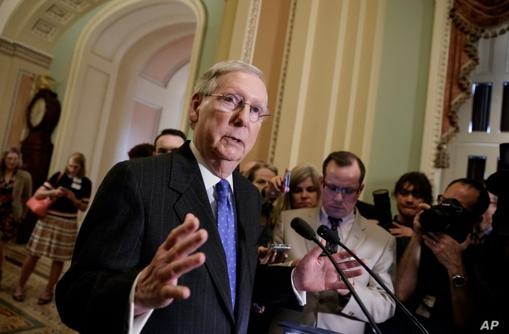 Senate Majority Leader Mitch McConnell of Kentucky speaks to reporters on Capitol Hill, April 4, 2017, about the struggle to move Supreme Court nominee Neil Gorsuch toward a final up-or-down vote on the Senate floor.