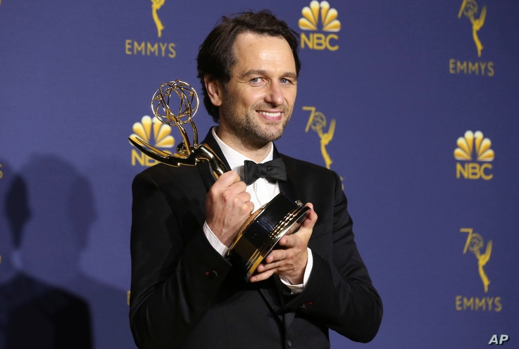 "Matthew Rhys poses in the press room with the award for outstanding lead actor in a drama series for ""The Americans"" at the 70th Primetime Emmy Awards, Sept. 17, 2018, at the Microsoft Theater in Los Angeles."