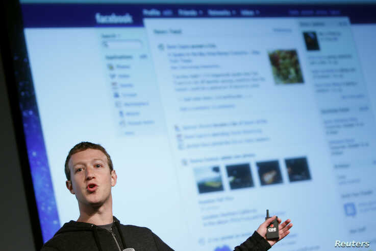 Facebook CEO Mark Zuckerberg gestures while speaking to the audience during a media event at Facebook headquarters in Menlo Park, California March 7, 2013.