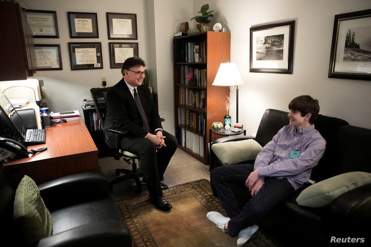 Dr. Chris Tuell, Clinical Director of Addiction Services, poses with Danny Reagan, a former residential patient of the Lindner Center of Hope, in Mason, Ohio, Jan. 23, 2019.
