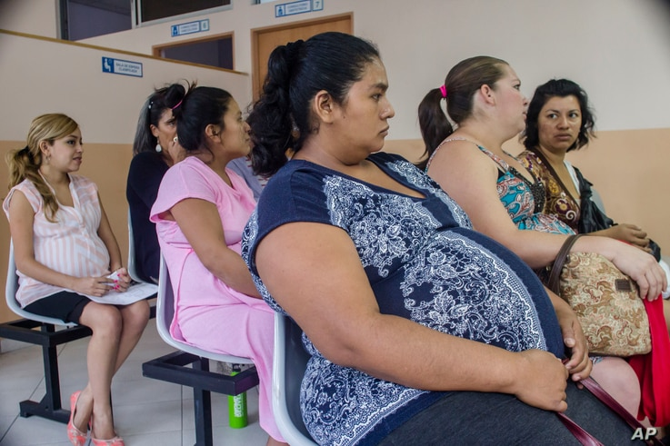 In this Jan. 29, 2016 photo, women wait their turn for their pre-natal exams at the National Hospital for Women in San Salvador, El Salvador.