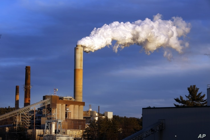 FILE - A plume of steam billows from the coal-fired Merrimack Station in Bow, N.H., Jan. 20, 2015.