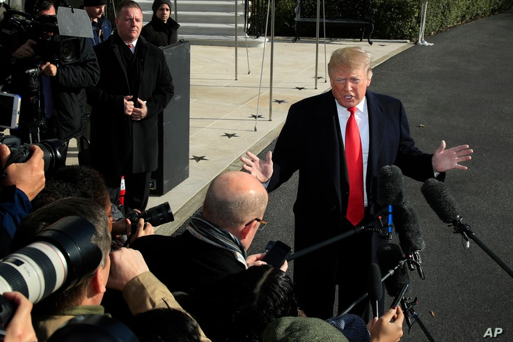 President Donald Trump speaks to reporters on the South Lawn before leaving the White House in Washington, Nov. 29, 2018 to attend the G20 Summit in Buenos Aires, Argentina.