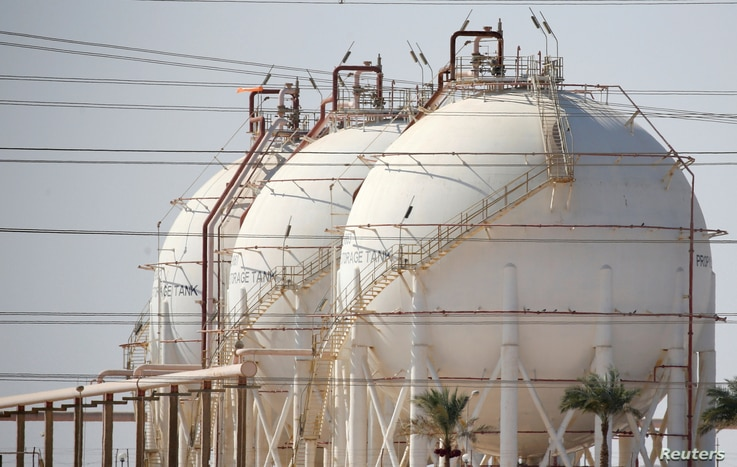 FILE - A plant's gas tanks are seen at the desert road of Suez city north of Cairo, Egypt, Aug. 14, 2016.