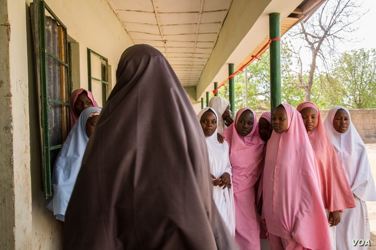 Students from Dapchi girls school return to school for the first day after Boko Haram invaded the campus in February, abducting more than 100 students.