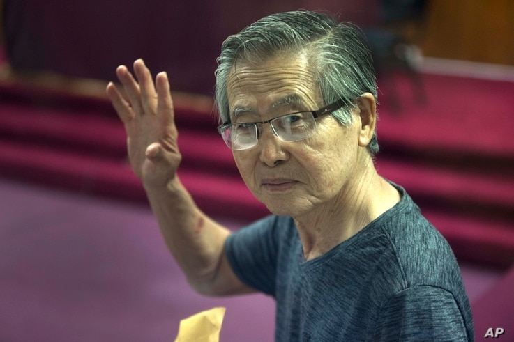 Former Peruvian President Alberto Fujimori, photographed through a window, attends the final sentencing of his embezzlement trial at a police base on the outskirts of Lima, Jan. 8, 2015.