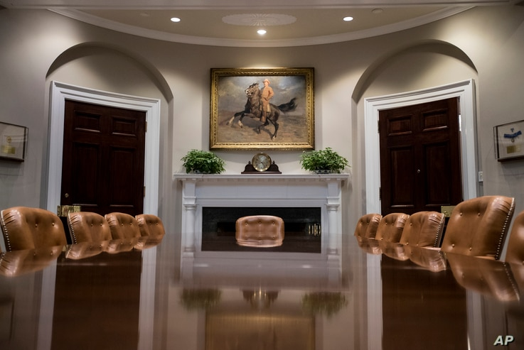 "A portrait of Teddy Roosevelt ""The Rough Rider"" by Tadé (Thadeus) Styka is seen in the newly renovated Roosevelt Room of the White House in Washington, Aug. 22, 2017, during a media tour."