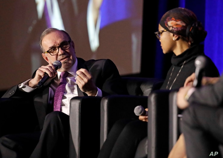 Carlos Sada, left, Mexico's ambassador to the United States, takes part in a panel discussion during a session of the National Immigration Integration Conference Monday, Dec. 12, 2016, in Nashville, Tenn.