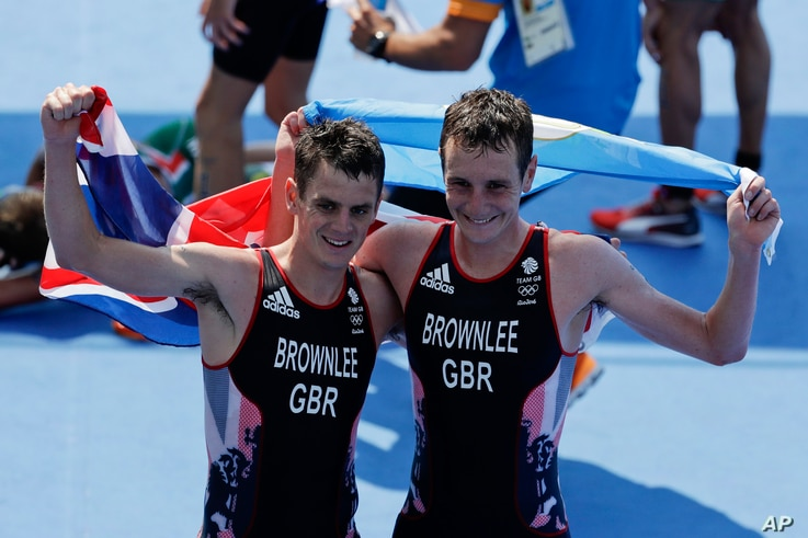Britain's Alistair, right, and Jonathan Brownlee react after the men's triathlon event of the 2016 Summer Olympics in Rio de Janeiro, Brazil, Aug. 18, 2016. Alistair won the gold medal and Jonathan the silver in the event.