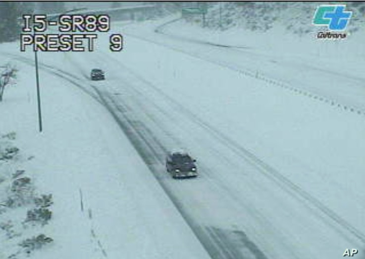 This image from a Caltrans traffic camera shows snow on the Interstate 5 and Highway 89 junction near Mt. Shasta, Calif., Wednesday, Feb. 13, 2019.