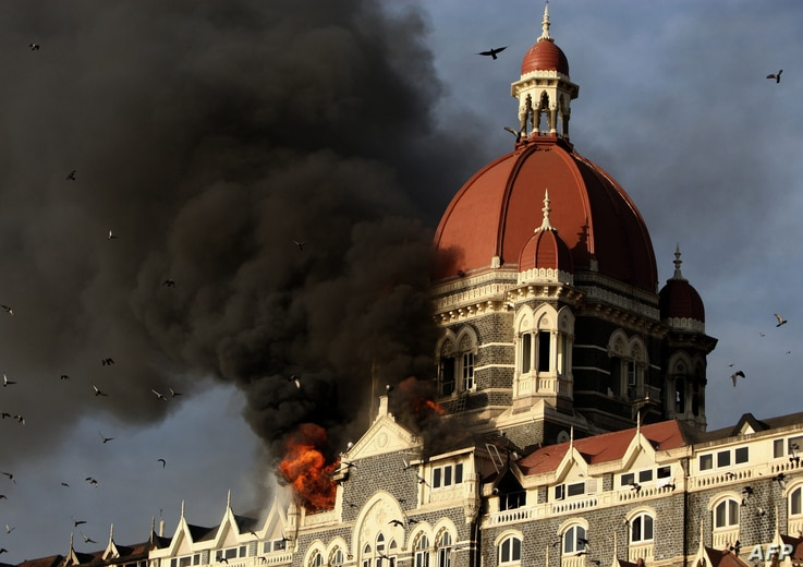 Flames gushing out of The Taj Mahal Hotel in Mumbai on November 27, 2008. Indian police have arrested a key suspect accused of co-coordinating the 2008 Mumbai terror attacks in which 166 people were killed and more than 300 wounded, media reports sai...