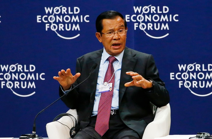 Prime Minister Hun Sen of Cambodia gestures as he talks about his vision for the Mekong region in the World Economic Forum on ASEAN at the National Convention Center Wednesday, Sept. 12, 2018, in Hanoi, Vietnam. The World Economic Forum has attracted...