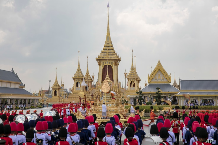 The ceremonial urn of Thailand's late King Bhumibol Adulyadej arrives at the crematorium during the funeral procession as royal crematorium is seen in the background in Bangkok, Thailand, Oct. 26, 2017.