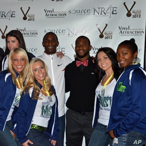 """Olympic long jump hopeful Norris Frederick (in white jacket) poses with """"celebrity dates"""" at a fundraising auction in Seattle."""
