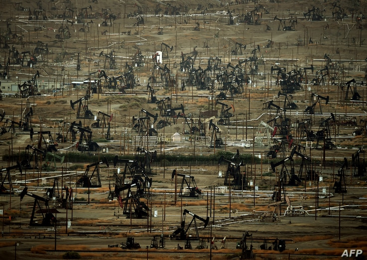 A general view shows oil pumping jacks and drilling pads at the Kern River Oil Field where the principle operator is the Chevron Corporation in Bakersfield, California on July 28, 2015.