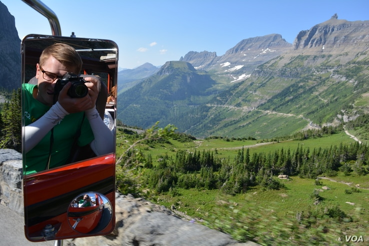 """The 33 Red Buses of Glacier National Park, nicknamed """"The Rubies of the Rockies,"""" on average, transport 60,000 tourist each summer."""