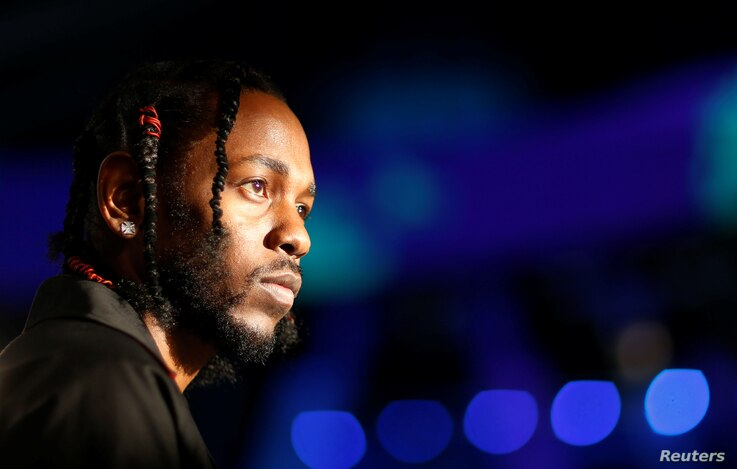 FILE - Musician Kendrick Lamar arrives at the 2017 MTV Video Music Awards in Inglewood, California, Aug. 27, 2017.