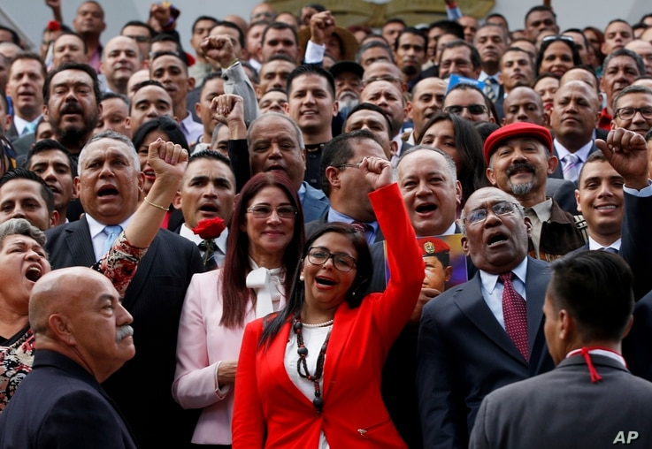 The President of Venezuela's Constituent Assembly Delcy Rodriguez, front and center, leads the newly sworn-in Constituent Assembly as they pose for an official photo in front of Venezuela's National Assembly in Caracas, Venezuela, Aug. 4, 2017.