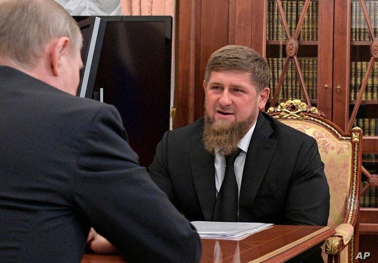 Russian President Vladimir Putin, left, meets with Chechnya's regional leader Ramzan Kadyrov in the Kremlin in Moscow, Russia, April 19, 2017.