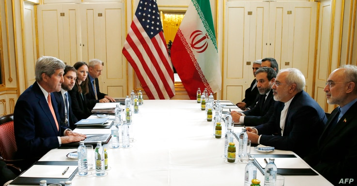 "US Secretary of State John Kerry (L)  meets with Iranian Foreign Minister Javad Zarif (2R) in Vienna, Austria on Jan. 16, 2016, on what is expected to be ""implementation day,""  the day the IAEA verifies that Iran has met all conditions under the nucl..."