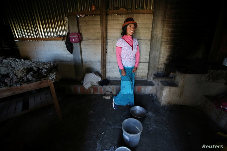 Margot Portilla stands in the kitchen of her home in the town of Nueva Fuerabamba in Apurimac, Peru, Oct. 3, 2017.