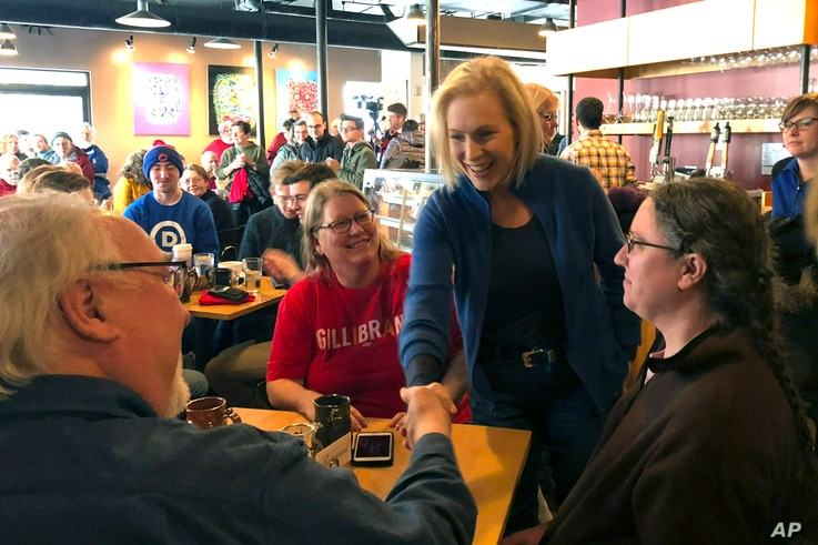 Sen. Kirsten Gillibrand, D-N.Y. greets patrons at Stomping Grounds Cafe in Ames, Iowa, on Saturday, Jan. 19, 2019.