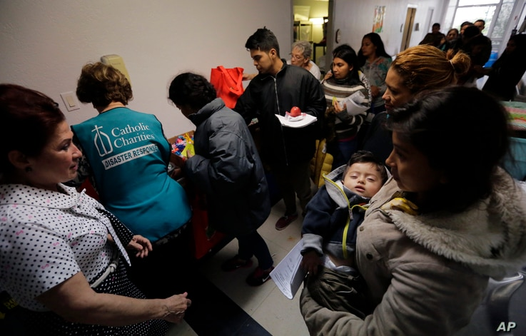 Darly Sotto, 21, of Guatemala holds her son, 1-year-old Jorge Sotto, as people check into the Catholic Charities shelter in McAllen, Texas, Jan. 11, 2019. As parents flee Central America with their young children, advocates argue a border wall would ...