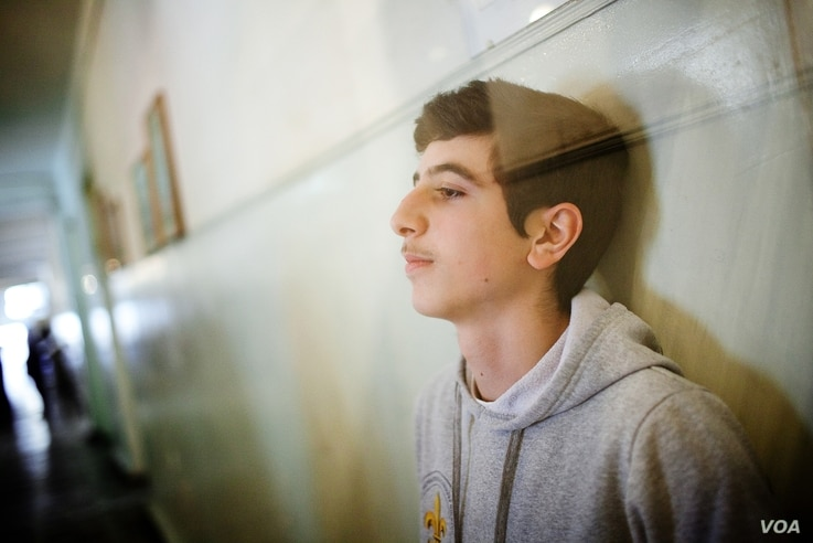 Aren Kurumlian, aged 15, left Aleppo, Syria for a 2-week Boy Scout Camp in Armenia.  Nine months later, he and his family are living in Yerevan, Armenia, February 20, 2013. (V. Undritz/VOA)