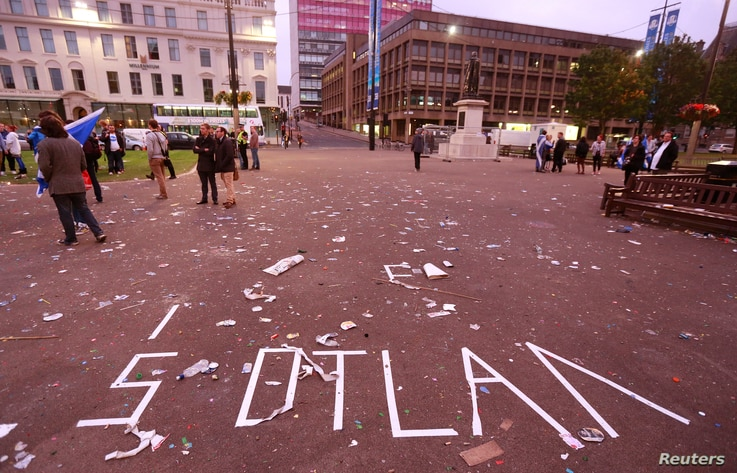 """The remnants of a message written in tape by """"Yes"""" campaign supporters is seen in George Square after Scotland voted against becoming an independent country, in Glasgow, Scotland, Sept. 19, 2014."""