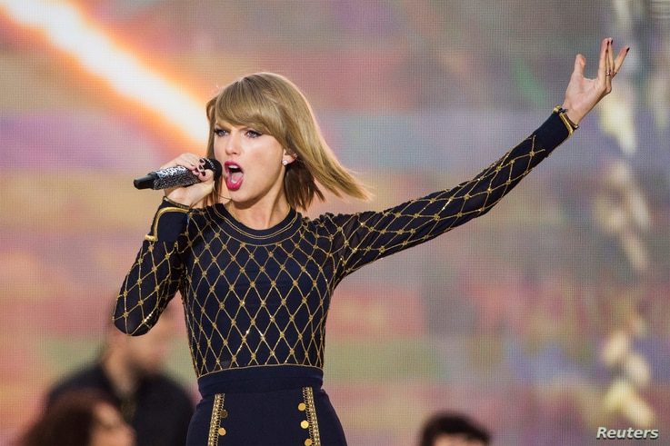 """Singer Taylor Swift performs on ABC's """"Good Morning America"""" to promote her new album """"1989"""" in New York, Oct. 30, 2014."""