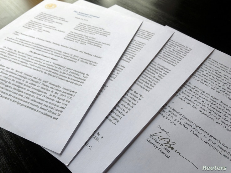 FILE - US Attorney General William Barr's signature is seen on a four-page letter to U.S. congressional leaders on the conclusions of Special Counsel Robert Mueller's report on Russian 2016 election meddling after the letter was released by the House...