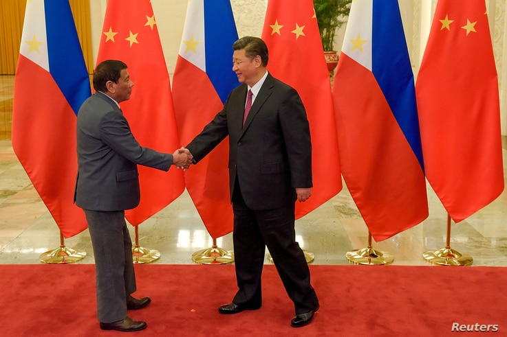 Chinese President Xi Jinping (R) shakes hands with Philippines President Rodrigo Duterte prior to their bilateral meeting during the Belt and Road Forum, at the Great Hall of the People in Beijing, China, May 15, 2017