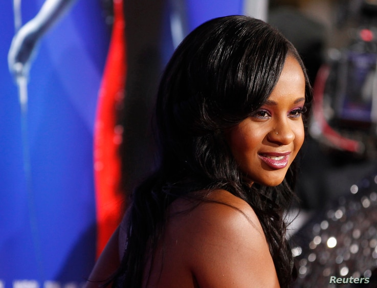 """FILE - Bobbi Kristina Brown, daughter of the late singer Whitney Houston and singer Bobby Brown, poses at the premiere of """"Sparkle"""" in Hollywood, California, August 16, 2012."""