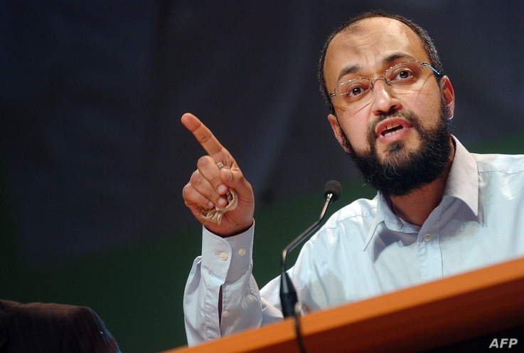 FILE - Hani Ramadan delivers a speech during the annual meeting of muslims in France, 14 Apr. 2007 in Le Bourget, north of Paris.